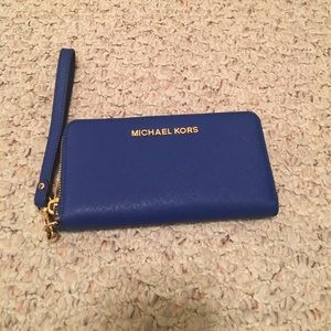 Michael Kors blue clutch w/ gold trim